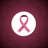 Cinta adornada del cáncer de pecho en fondo rosado abstracto Fotos de archivo