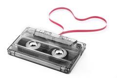 Cinta de casete con la cinta de la forma del corazón imagen de archivo