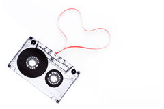 Cinta de casete con la cinta de la forma del corazón Foto de archivo libre de regalías