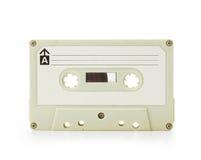 Cinta de cassette de las comienzos de los años 70 aislada en blanco Imagen de archivo libre de regalías