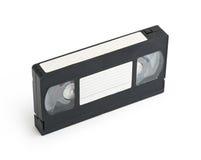 Cinta de cinta de video vieja de VHS con la escritura de la etiqueta en blanco Fotografía de archivo libre de regalías