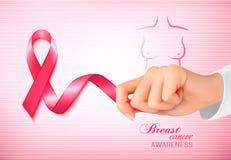 Cinta de la conciencia del cáncer de pecho en un fondo rosado Fotografía de archivo
