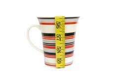 Cinta de la medida y taza de café imagen de archivo libre de regalías