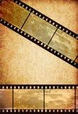 Cinta de la película en viejo fondo de papel de la vendimia stock de ilustración