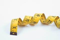 Cinta de medición de la personalización Fotografía de archivo libre de regalías