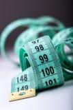 Cinta de medición de la personalización Opinión del primer la cinta métrica blanca Imágenes de archivo libres de regalías