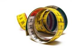 Cinta de medición rodada Fotos de archivo libres de regalías