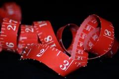 Cinta de medición roja Fotografía de archivo libre de regalías