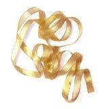 Cinta de oro, en el fondo blanco Foto de archivo