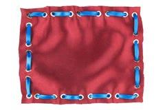 Cinta de satén azul insertada en la cuaderna del oro hecha de la seda roja imagen de archivo