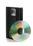 Cinta de video análoga con el disco del DVD Fotografía de archivo