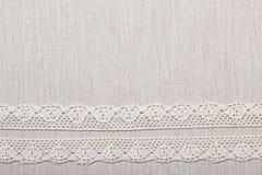 Cinta del cordón en fondo del paño de lino Foto de archivo