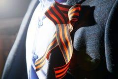 Cinta del ` s de San Jorge en la solapa de la chaqueta Foto de archivo libre de regalías