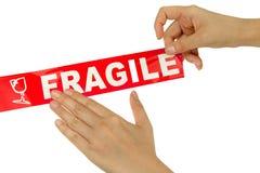 cinta frágil roja Imagenes de archivo