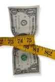 Cinta métrica alrededor del dólar Foto de archivo libre de regalías