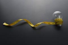 Cinta métrica con el bulbo Foto de archivo libre de regalías