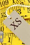Cinta métrica con la etiqueta con la talla Fotografía de archivo libre de regalías