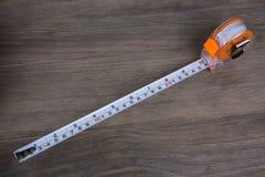 Cinta métrica, construcción que estima las herramientas fotos de archivo libres de regalías