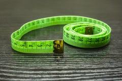 Cinta métrica plástica verde métrica Fotografía de archivo