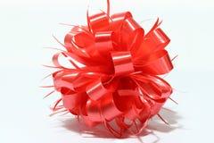 Cinta roja del Año Nuevo de la esfera en el fondo blanco Imagen de archivo
