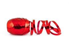 Cinta roja del regalo de la hoja de la Navidad Foto de archivo