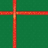 Cinta roja en el papel de color verde para el festival de la Navidad Foto de archivo libre de regalías