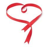Cinta roja en forma de corazón Fotografía de archivo