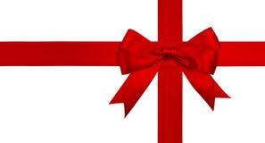 Cinta roja y arqueamiento del regalo aislados Imagen de archivo
