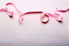 Cinta rosada en fondo ligero Imágenes de archivo libres de regalías