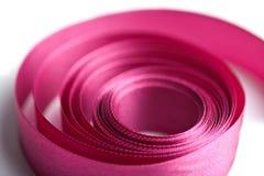 Cinta rosada hermosa en la forma espiral aislada Fotografía de archivo libre de regalías
