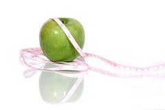 Cinta verde de la manzana y del measurment Imagen de archivo