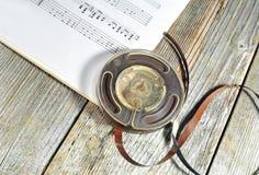 Cinta vieja con las notas de la música Foto de archivo libre de regalías