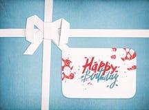 Cinta y arco del regalo con las letras del feliz cumpleaños Fotografía de archivo libre de regalías