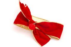 Cinta y arqueamiento rojos del terciopelo Foto de archivo