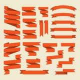 Cintas anaranjadas fijadas aisladas en el fondo blanco Fotos de archivo libres de regalías