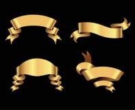Cintas de oro en fondo negro Foto de archivo libre de regalías