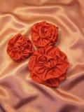 Cintas en el satén Imagenes de archivo