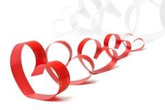 Cintas formadas como corazones en blanco Imagen de archivo