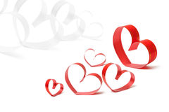 Cintas formadas como corazones en blanco Fotos de archivo
