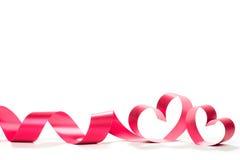 Cintas formadas como corazones en blanco Fotografía de archivo libre de regalías