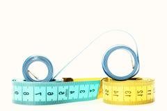 Cintas para la cintura de medición con los indicadores de la forma de centímetros foto de archivo libre de regalías
