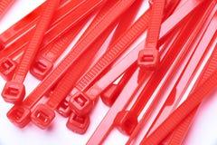 Cintas plásticas vermelhas Foto comercial no fundo branco fotografia de stock royalty free