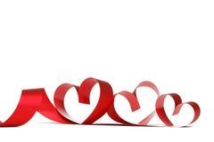 Cintas rojas del corazón Imágenes de archivo libres de regalías