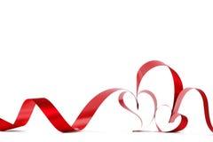 Cintas rojas del corazón Foto de archivo libre de regalías