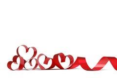 Cintas rojas del corazón Imagen de archivo