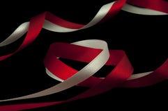 Cintas rojas y blancas Imagen de archivo