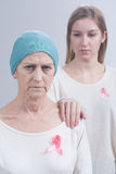 Cintas rosadas que llevan como símbolo fotos de archivo