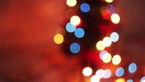 Cintilação borrada das luzes de Natal, bonita filme