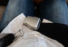 Cinturón de seguridad desbloqueado del aeroplano sobre revestimiento del pasajero Fotos de archivo