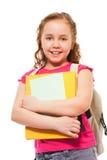 Menina de sorriso feliz com a pilha dos livros fotografia de stock